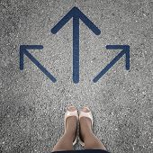 stock photo of crossroads  - Top view of businesswoman feet standing at crossroads - JPG