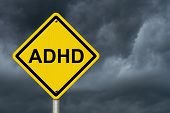 picture of warning-signs  - Warning Signs of ADHD An American road warning sign with word ADHD with a stormy sky background - JPG