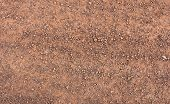 stock photo of sand gravel  - Ground and gravel on the road in a rural community - JPG