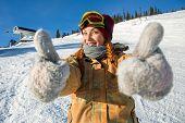 foto of snowboarding  - Girl snowboarder in a good mood - JPG