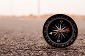 foto of longitude  - Travel Concept Compass on the Asphlat Road - JPG