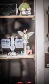 stock photo of faerys  - A small satue of a faery smiling in a shop - JPG
