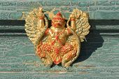 pic of garuda  - the old garuda statue at the old wall - JPG