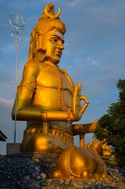 picture of lingam  - Statue of Lord Shiva with his lingam at Koneswaram temple an important hindu shrine in the Tamil region of Trincomalee Sri Lanka - JPG