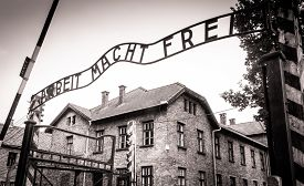 stock photo of auschwitz  - Arbeit macht frei sign (Work liberates) in concentration camp Auschwitz, Poland