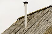 stock photo of chimney  - Old roof with chimney in the village - JPG