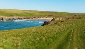stock photo of polly  - Porth Joke beach next to Crantock bay Cornwall England UK near Newquay and on South West Coast Path also known as Polly Joke in spring with blue sea and sky - JPG