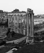 stock photo of saturn  - Part of the Temple of Saturn and Temple of Vespasian and Titus ruins in Rome - JPG