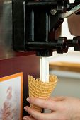 pic of ice cream parlor  - filling of soft ice cream waffle cone - JPG
