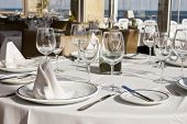picture of crockery  - Table crockery setting in a restaurant next to the sea - JPG