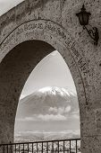 picture of monochromatic  - Monochromatic view of volcano Misti Arequipa Peru framed by arch in Yanahuara square - JPG
