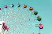 picture of color wheel  - Colorful Giant ferris wheel against blue sky background - JPG