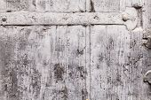 stock photo of pale  - Brittle texture of the paint coat on a wooden window shutter - JPG