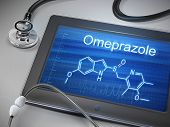 stock photo of gastritis  - omeprazole word displayed on tablet with stethoscope over table - JPG