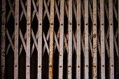 stock photo of roller shutter door  - the old metal roller shutter gate background - JPG
