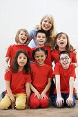 picture of drama  - Group Of Children With Teacher Enjoying Drama Workshop Together - JPG