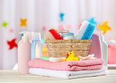 pic of bathing  - Baby accessories for bathing on table on light background - JPG