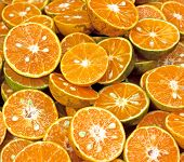 foto of clementine-orange  - Tangerine segments orange background texture of fresh fruit - JPG