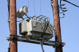 stock photo of transformer  - Old electric power transformer on a post - JPG