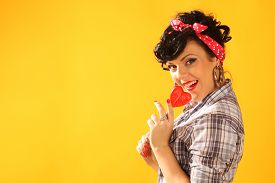 picture of lollipops  - pin up girl with heart shaped lollipop - JPG