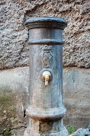 foto of spqr  - Old aged typical roman fountain for drinkable water with SPQR sign - JPG