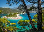 Oludeniz beach full of relaxing people and the Blue Lagoon, Fethiye, Turkey poster