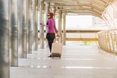 Woman Traveller In Airport Walkway. Travel Concept. poster