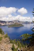 stock photo of klamath  - View of Crate Lake and Wizard island in southern Oregon and extinct volcano that left his large caldera - JPG