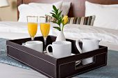 foto of bed breakfast  - Breakfast tray on a bed - JPG