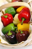 Basket Of Colorful Bell Peppers poster