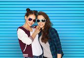 people, summer and fashion concept - happy smiling pretty teenage girls or friends in sunglasses ove poster