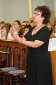 KAPOSVAR, HUNGARY - AUGUST 26: Judit Majnay conducts at the IV. Pannonia Cantat Youth Choir Festival