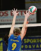 KAPOSVAR, HUNGARY - NOVEMBER 14: Rebeka Rak blocks the ball at the Hungarian NB I. League woman voll