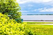 Green Summer Bushes And Tree In Landscaped Park In Portneuf, Quebec, Canada, With View Of Saint Lawr poster