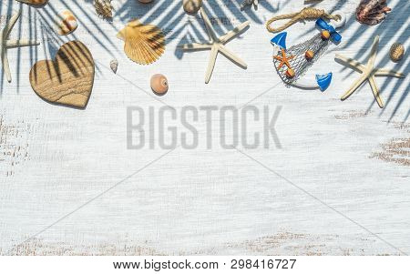 poster of Flat Lay Of Sea Shells, Starfish And Palm Leaf Shadow On Grunge White Wooden Background. Background