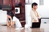 picture of indian money  - young indian couple arguing on money in home kitchen - JPG