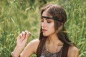 Portrait Of Beautiful Hippie Girl Sitting On Grass poster