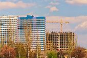 Spring Landscape View Of The Process Of Building Multistorey Residential  Buildings. Building Crane  poster