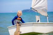 Child Sailing. Kid Learning To Sail On Sea Yacht. poster