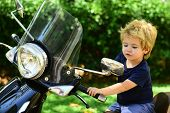 Cute Child Tries Riding Motorbike Alone. Cheerful Happy Sincere Emotions On Fresh Air. Emotional Kid poster