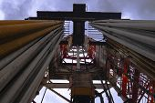 Oil And Gas Drilling Rig Onshore Dessert With Dramatic Cloudscape. Oil Drilling Rig Operation On The poster