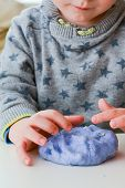 Playing With Home Made Slime. Child Plays With Slime Made From Recipe poster