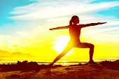 Yoga well-being woman training outdoors in morning sunrise. Wellness and health concept. Silhouette  poster