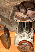 Old Vintage Irons. Heavy Antique Ironing Irons. poster