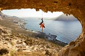 Rock Climber Hanging On Rope After Falling Of Cliff, Climbing In Cave. Kalymnos Island, Greece. poster