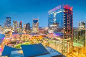 Nashville, Tennessee, USA downtown city skyline rooftop view at dusk. poster