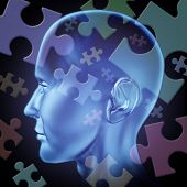 image of brain teaser  - Puzzled mind and brain teasers symbol featuring a human head with jigsaw puzzle peices representing the concept of riddles of thinking and problem solving to find a solution and answers to mysteries of the brain - JPG