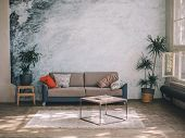 Interior Design. Furniture Against A Blue Wall And Wooden Floor - A Blue-gray Sofa With Pillows, A P poster