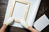 Canvas Stretching Process. Wooden Stretcher Bar, Canvas Pliers, Male Hand In White Protect Gloves poster