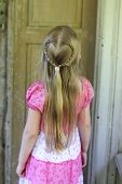 A Little Girl With A Heart Braid In Her Long Hair. poster